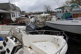 Boats smashed to the ground in the Sheapsheadbay neighborhood due to flooding from Hurricane Sandy — Stock Photo