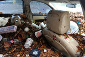 Debris litters inside abondoned cars in the Sheapsheadbay neighborhood due to flooding from Hurricane Sandy — Stock Photo