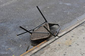 Smashed chair on the ground in the Sheapsheadbay neighborhood due to flooding from Hurricane Sandy — Stock Photo