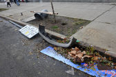 Debris litters the ground in the Sheapsheadbay neighborhood due to flooding from Hurricane Sandy — Stock Photo