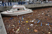 Debris litters the water in the Sheapsheadbay neighborhood due to flooding from Hurricane Sandy — Stock Photo