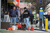 BROOKLYN, NY - NOVEMBER 01: Peoplepumping water out buildings at the Brighton Bwach neighborhood due to impact from Hurricane Sandy in Brooklyn, New York, U.S., on Thursday, November 01, 2012. — Stock Photo