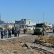 NEW YORK, NY - NOVEMBER 09: U.S. Marines  move a debris and parts of destroyed houses in the Breezy Point part of Far Rockaway on November 9, 2012 in the Queens borough of NY - Stock Photo