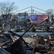 Stock Photo: NEW YORK, NY - NOVEMBER 09: Americflag flies from burned house in damaged areNovember 9, 2012 in Breezy Point part of Far Rockaway in Queens borough of NY.