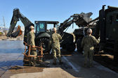 NEW YORK, NY - NOVEMBER 09: U.S. Marines move a debris and parts of destroyed houses in the Breezy Point part of Far Rockaway on November 9, 2012 in the Queens borough of NY — Stock Photo