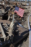 NEW YORK, NY - NOVEMBER 09: An American flag flies from the burned house in a damaged area November 9, 2012 in the Breezy Point part of Far Rockaway in the Queens borough of NY. — Stock Photo