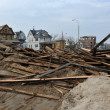 QUEENS, NY - NOVEMBER 11: Buildings and boardwalk ruins after massive impact from Hurricane Sand in the Rockaway Beach in Queens, New York, U.S., on November 11, 2012. — Stock Photo #14807665