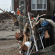 QUEENS, NY - NOVEMBER 11: U.S. Navy working on the streets ater massive destruction in the Rockaway Beach area due to impact from Hurricane Sandy in Queens, New York, U.S., on November 11, 2012. — Stock Photo