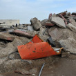 QUEENS, NY - NOVEMBER 11: Buildings and boardwalk ruins after massive impact from Hurricane Sand in the Rockaway Beach in Queens, New York, U.S., on November 11, 2012. — Stock Photo #14807733
