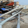 QUEENS, NY - NOVEMBER 11: Buildings and boardwalk ruins after massive impact from Hurricane Sand in the Rockaway Beach in Queens, New York, U.S., on November 11, 2012. — Stock Photo #14807739