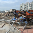 QUEENS, NY - NOVEMBER 11: Buildings and boardwalk ruins after massive impact from Hurricane Sand  in the Rockaway Beach in Queens, New York, U.S., on November 11, 2012. - Stock Photo