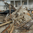 QUEENS, NY - NOVEMBER 11: Buildings and boardwalk ruins after massive impact from Hurricane Sand in the Rockaway Beach in Queens, New York, U.S., on November 11, 2012. — Stock Photo #14807757