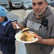 QUEENS, NY - NOVEMBER 11: getting help with hot food, clothes and supplies in the Rockaway beach area after impact from Hurricane Sandy in Queens, New York, U.S., on November 11, 2012. — ストック写真