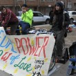 QUEENS, NY - NOVEMBER 11: Bicyclists generate pedal power to help aftermath recovery in the Rockaway Beach area due to impact from Hurricane Sandy in Queens, New York, U.S., on November 11, 2012. - Stock Photo