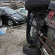 QUEENS, NY - NOVEMBER 11: Deamaged cars at parking lot in the Rockaway due to impact from Hurricane Sandy in Queens, New York, U.S., on Novemeber 11, 2012. - Stock Photo