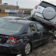 QUEENS, NY - NOVEMBER 11: Deamaged cars at parking lot in Rockaway due to impact from Hurricane Sandy in Queens, New York, U.S., on Novemeber 11, 2012. — Stock Photo #14808007