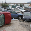 QUEENS, NY - NOVEMBER 11: Deamaged cars at parking lot in the Rockaway due to impact from Hurricane Sandy in Queens, New York, U.S., on Novemeber 11, 2012. - Zdjęcie stockowe