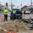 QUEENS, NY - NOVEMBER 11: Damaged road and aftermath recovery in the Rockaway area due to impact from Hurricane Sandy in Queens, New York, U.S., on November 11, 2012. - Stock Photo