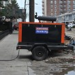 Stock Photo: QUEENS, NY - NOVEMBER 11: Damaged homes getting power from generators in Rockaway aredue to impact from Hurricane Sandy in Queens, New York, U.S., on November 11, 2012.