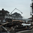 QUEENS, NY - NOVEMBER 11: Damaged homes and boardwalk aftermath recovery in the Rockaway beach area due to impact from Hurricane Sandy in Queens, New York, U.S., on November 11, 2012. - Stock Photo