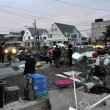QUEENS, NY - NOVEMBER 11: Deamaged homes and aftermath recovery in Rockaway aredue to impact from Hurricane Sandy in Queens, New York, U.S., on Novemeber 11, 2012. — Stock Photo #14808249