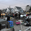 Stock Photo: QUEENS, NY - NOVEMBER 11: Deamaged homes and aftermath recovery in Rockaway aredue to impact from Hurricane Sandy in Queens, New York, U.S., on Novemeber 11, 2012.