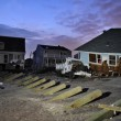 QUEENS, NY - NOVEMBER 11: Damaged houses without power at night in the Rockaway beach - Bel Harbor area due to impact from Hurricane Sandy in Queens, New York, U.S., on November 11, 2012. — Stock Photo #14808337