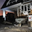 QUEENS, NY - NOVEMBER 11: Damaged houses without power at night in the Rockaway beach - Bel Harbor area due to impact from Hurricane Sandy in Queens, New York, U.S., on November 11, 2012. — Stock Photo #14808391