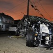 QUEENS, NY - NOVEMBER 11: Damaged car in the Rockaway beach area due to impact from Hurricane Sandy in Queens, New York, U.S., on November 11, 2012. - Stock Photo