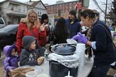 QUEENS, NY - NOVEMBER 11: Children getting help with hot food, clothes and supplies in the Rockaway beach area due to impact from Hurricane Sandy in Queens, New York, U.S., on November 11, 2012. — Stock Photo