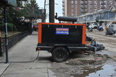 QUEENS, NY - NOVEMBER 11: Damaged homes getting power from generators in the Rockaway area due to impact from Hurricane Sandy in Queens, New York, U.S., on November 11, 2012. — Stock Photo