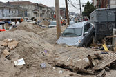 QUEENS, NY - NOVEMBER 11: Deamaged car in the Rockaway due to impact from Hurricane Sandy in Queens, New York, U.S., on Novemeber 11, 2012. — Stock Photo