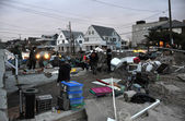 QUEENS, NY - NOVEMBER 11: Deamaged homes and aftermath recovery in the Rockaway area due to impact from Hurricane Sandy in Queens, New York, U.S., on Novemeber 11, 2012. — Stock Photo