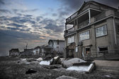 QUEENS, NY - NOVEMBER 11: Damaged houses without power at night in the Rockaway beach - Bel Harbor area due to impact from Hurricane Sandy in Queens, New York, U.S., on November 11, 2012. — Stock Photo