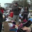 Stock Video: QUEENS, NY - NOVEMBER 11: getting help with hot food, clothes and supplies in Rockaway beach areafter impact from Hurricane Sandy in Queens, New York, U.S., on November 11, 2012.