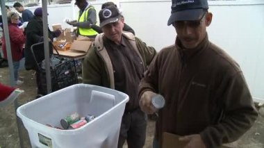 QUEENS, NY - NOVEMBER 11: getting help with hot food, clothes and supplies in the Rockaway beach area after impact from Hurricane Sandy in Queens, New York, U.S., on November 11, 2012. — Stock Video