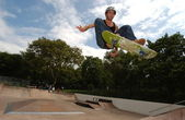 Skateboarder jumping in the halfpipe — Stock Photo