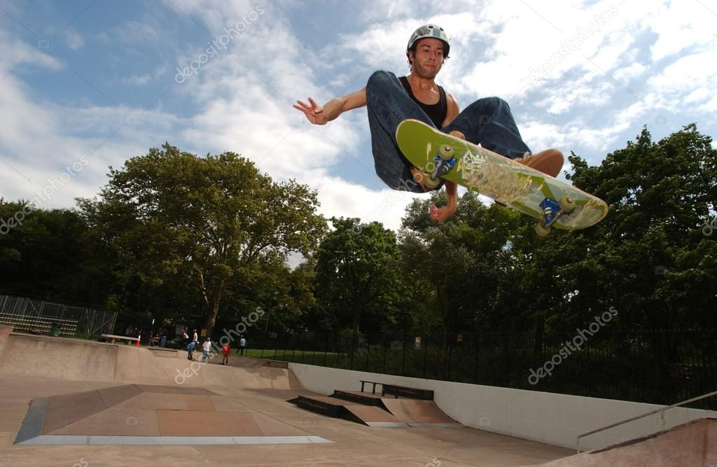 Skateboarder jumping in the halfpipe  Stock Photo #16058623