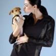 Portrait of sophisticated brunette woman holding small dog — Stock Photo #16662905