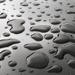 Drops of water on the metal surface — Stock Photo