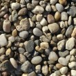 Naturally polished light rock pebbles background - Photo
