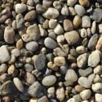 Naturally polished light rock pebbles background — Stock Photo