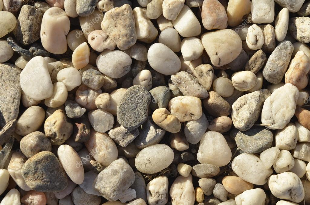 Naturally polished light rock pebbles background  — Stock Photo #17039087
