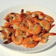 Cooked large shrimp on white plate - Stock Photo