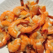 Cooked large shrimp on white plate -  