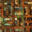 rusty metal pillars under the boardwalk of a seaside pier — Stock Photo