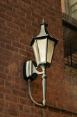 Street light on brick wall — Stock Photo