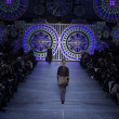 PARIS, FRANCE - MARCH 06: A model walks the runway at the Kenzo fashion show during Paris Fashion Week on March 6, 2011 in Paris, France. - Zdjcie stockowe