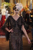 PARIS, FRANCE - MARCH 06: A model walks the runway at the John Galliano fashion show during Paris Fashion Week on March 6, 2011 in Paris, France. — Stock Photo