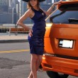 Fashion model posing pretty in front of sport SUV in New York NY — Stock Photo